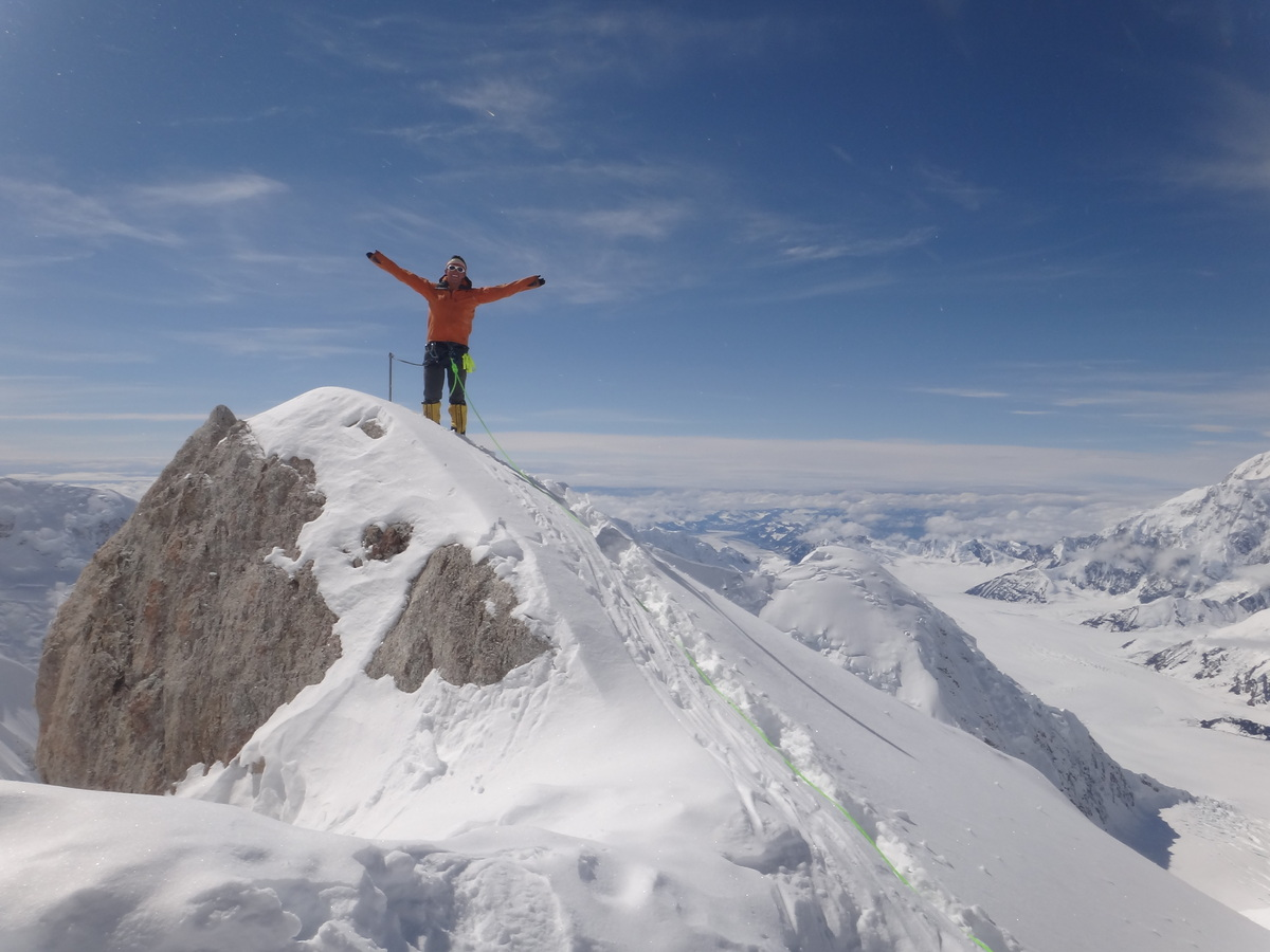 "Cason standing at the ""Edge of the World"" (14,200 feet) on Denali, the highest mountain in North America, summer 2012."