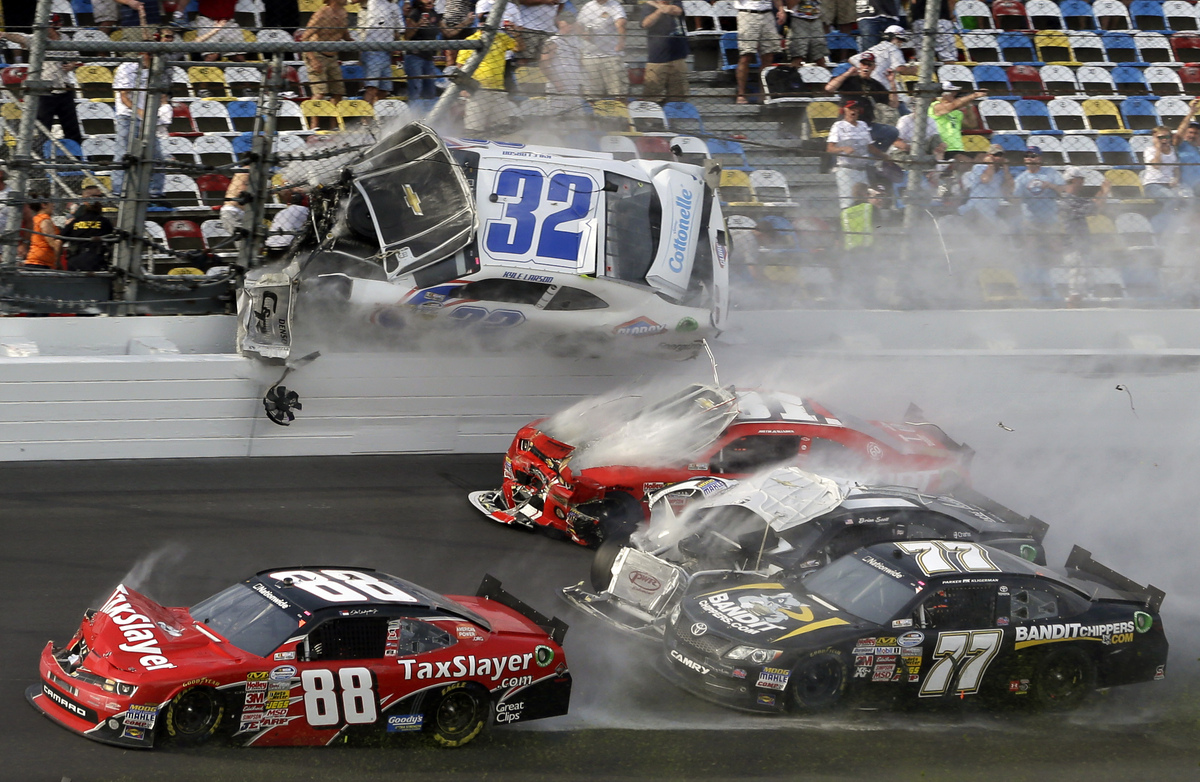 Kyle Larson (32) goes airborne into the catch fence in a multi-car crash including Dale Earnhardt Jr. (88), Parker Kilgerman