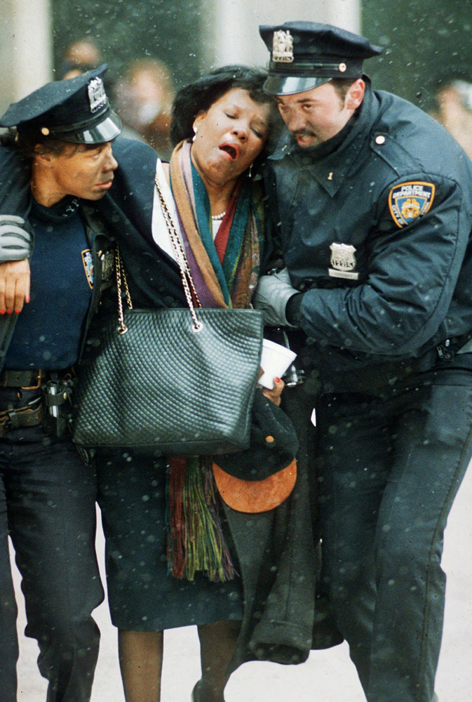 FILE - In this file photo of Feb. 26, 1993, two New York City police officers help an injured women away from the scene of th