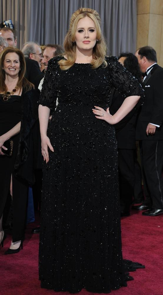 Best Original Song winner Adele Adkins arrives on the red carpet for the 85th Annual Academy Awards on February 24, 2013 in H