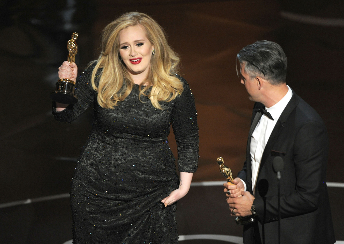 """Singer Adele, left, and musician/producer Paul Epworth accept the award for best original song for """"Skyfall"""" from """"Skyfall"""" d"""
