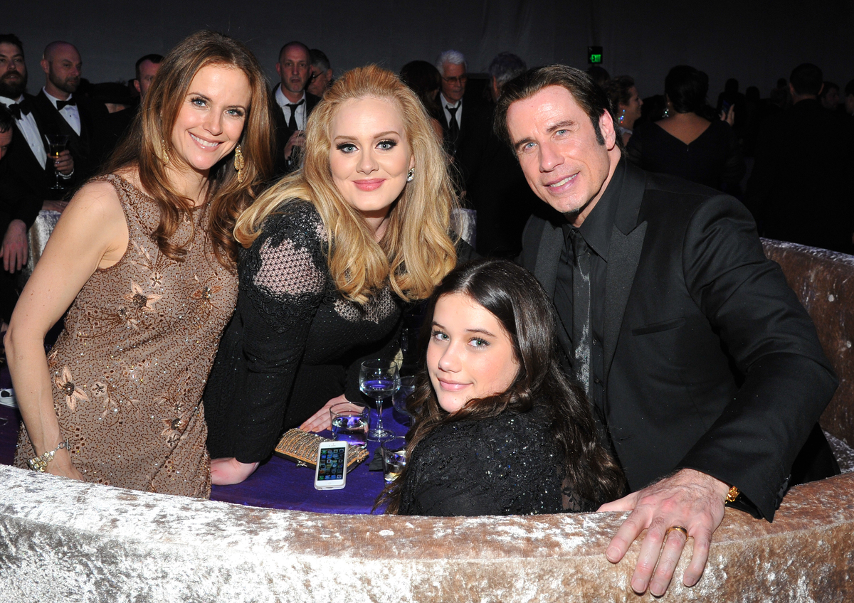 Kelly Preston, from left, singer Adele, Ella Bleu Travolta, and John Travolta attend the Governor's Ball following the Oscars