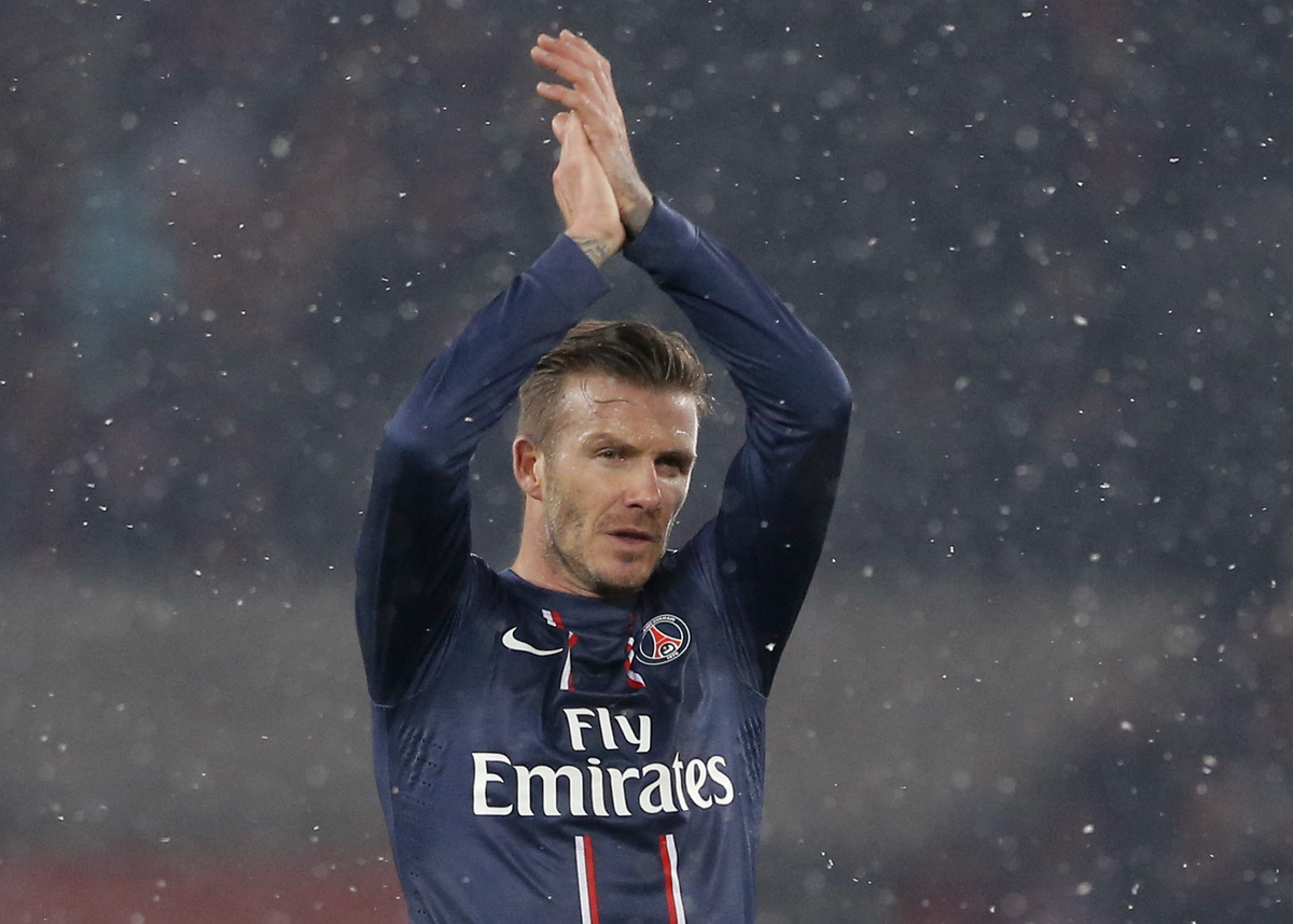 Paris Saint Germain's David Beckham applauds the crowd at the end of their League One soccer match against Marseille at Parc