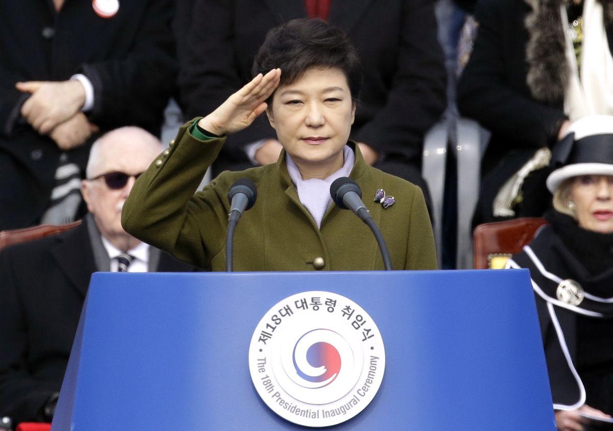 South Korea's new President Park Geun-hye salutes during her inauguration ceremony as the 18th South Korean president, at the