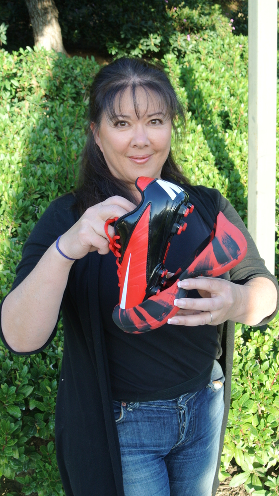 Marianne with a pair of Cleatskins. The durable, flexible rubber skins slip over cleats to preserve cleats, prevent slips and