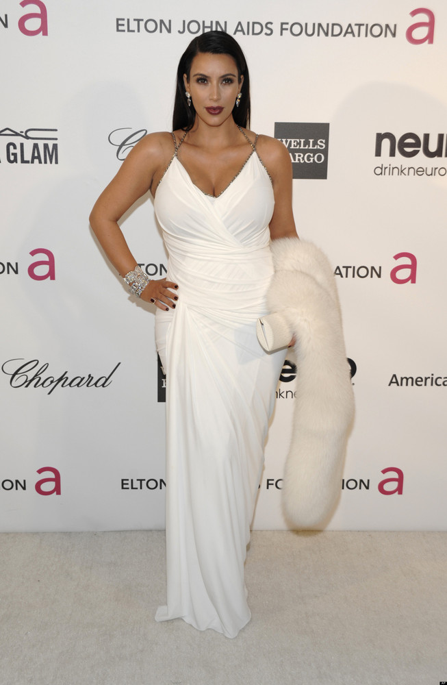 "Kim Kardashian, who's <em>still</em> in the process of <a href=""http://www.huffingtonpost.com/2013/02/14/kim-kardashian-divor"