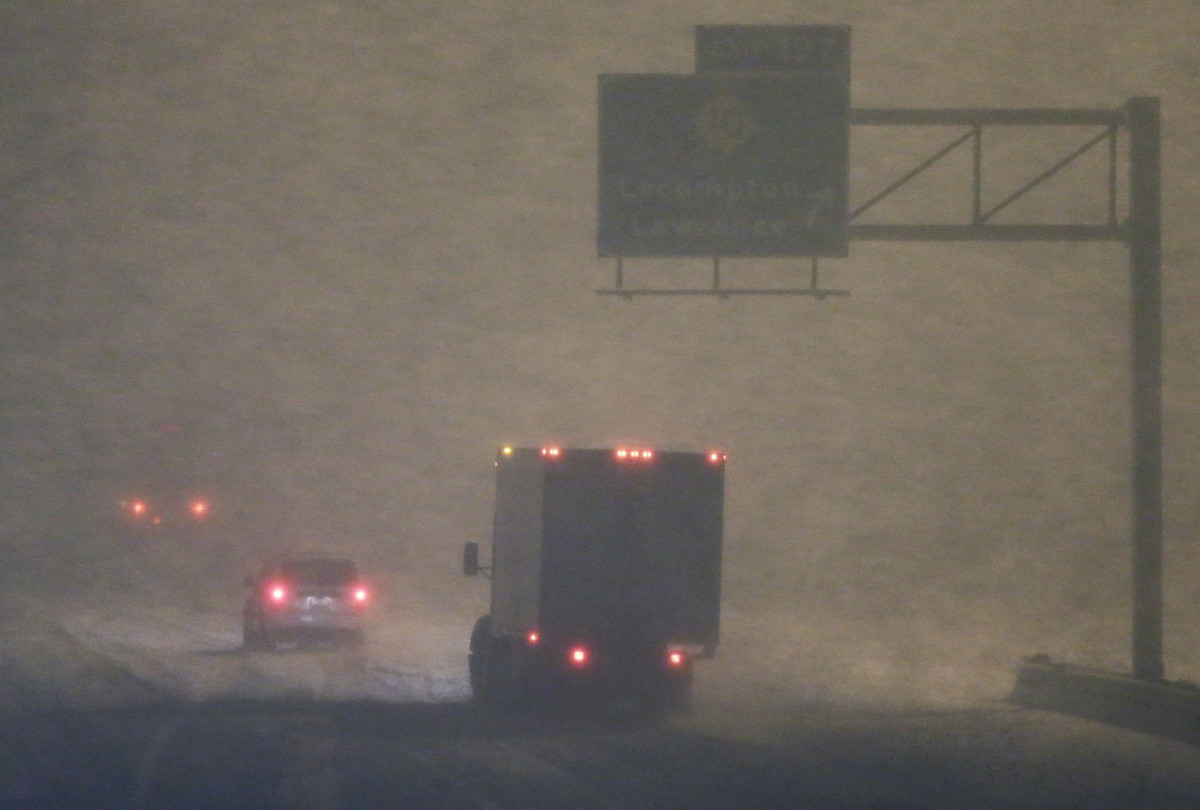 Traffic slows in near blizzard conditions along I-70 near Lawrence, Kan., Monday, Feb. 25, 2013. The winter storm could be th