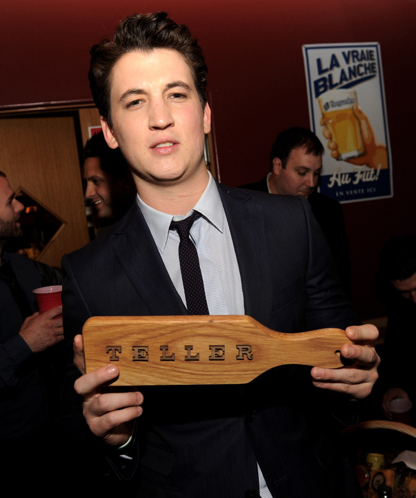 LOS ANGELES, CA - FEBRUARY 21:  Actor Miles Teller poses at the after party for the premiere of Relativity Media's '21 And Ov