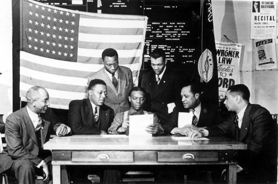 African-American UAW-CIO organizers at union headquarters plan a successful campaign to organize Ford workers during the 1941
