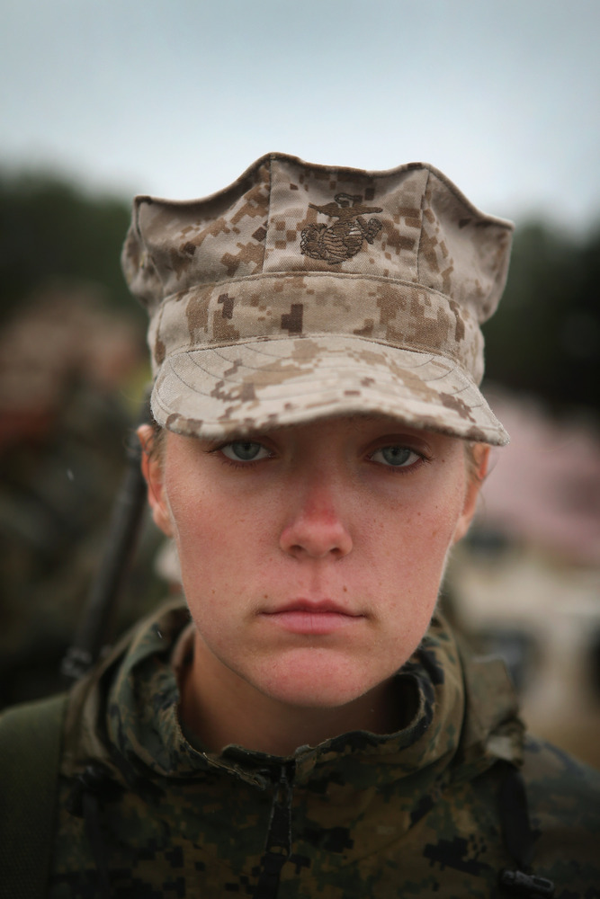 Marine recruit Jacklyn Powers, from Des Moines, Iowa waits with other female recruits to fire on the rifle range during boot