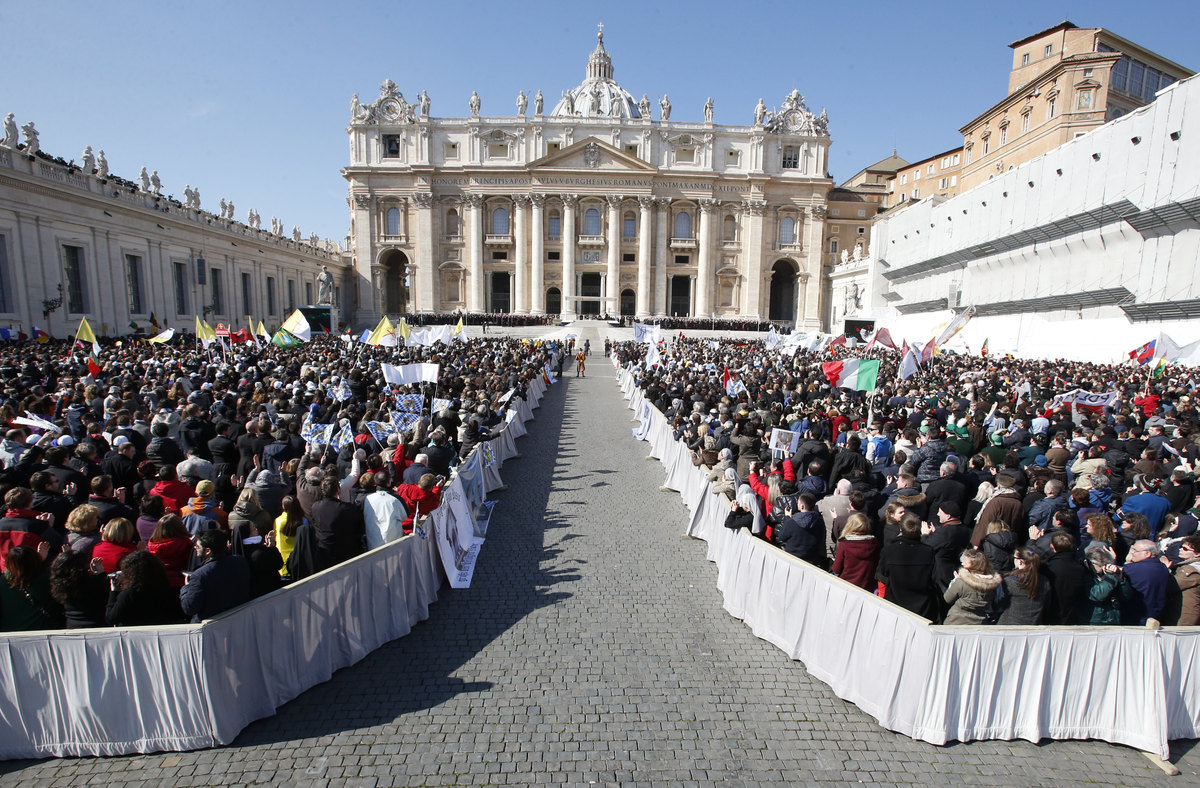 "Faithful gather in St. Peter's Square at the Vatican, Wednesday, Feb. 27, 2013. Pope Benedict XVI has recalled moments of ""jo"