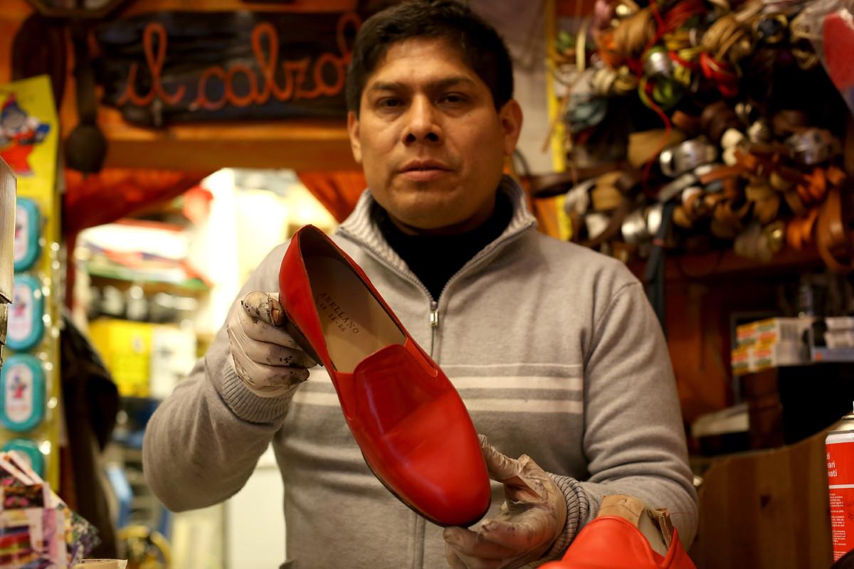 Pope Benedict XVI's shoemaker Antonio Arellano poses with the red shoes of the Pontiff on February 22, 2013 in Rome, Italy. T