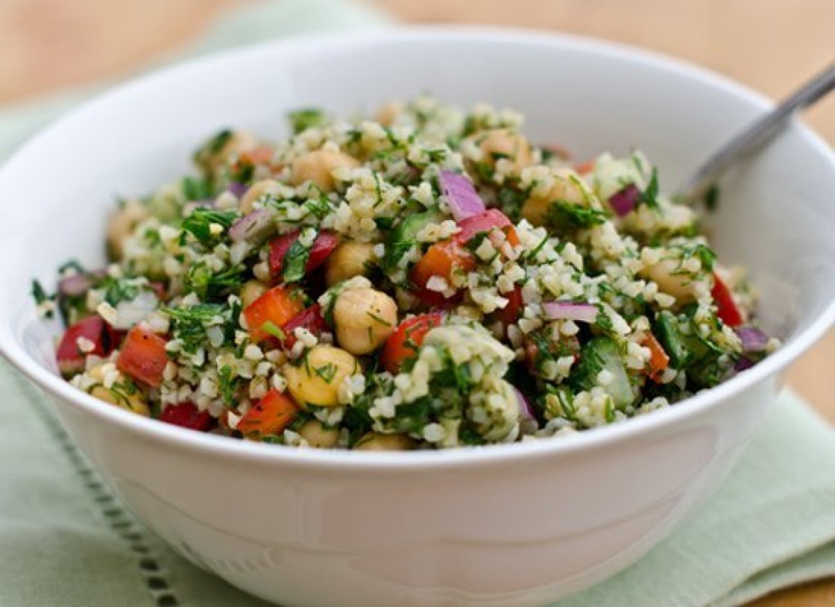 Chock-full of bulgur, fresh herbs, chopped vegetables and buttery chick peas, this salad is kind of like a bulked-up tabboule