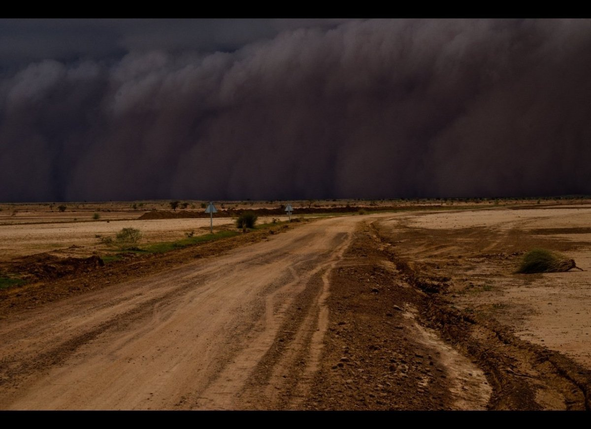 A sand and rain storm approaches as we travel to Timbuktu. The storm begins in the clouds and touches the ground. There is no