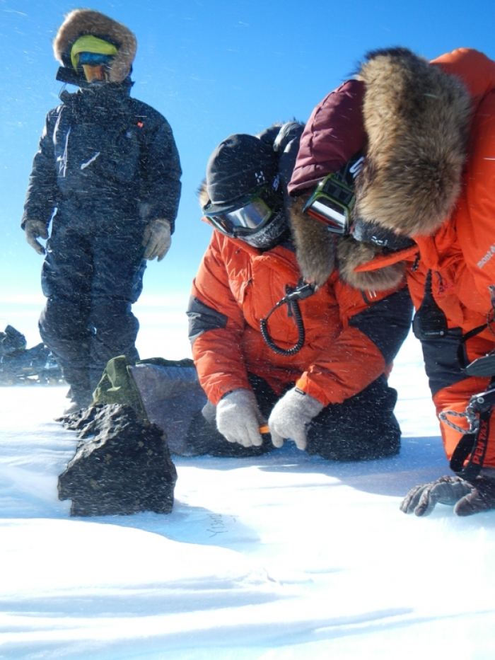Belgo-Japanese SAMBA meteorite team members examining an 18kg meteorite found during a field trip on the Nansen Ice Field, 14