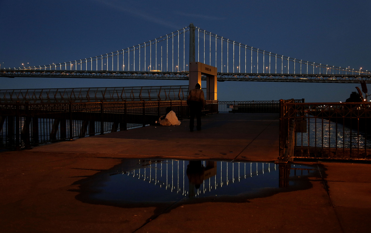 In this Wednesday, Feb. 20, 2013, photo, lights are reflected on the San Francisco-Oakland Bay Bridge on Pier 14 in San Franc