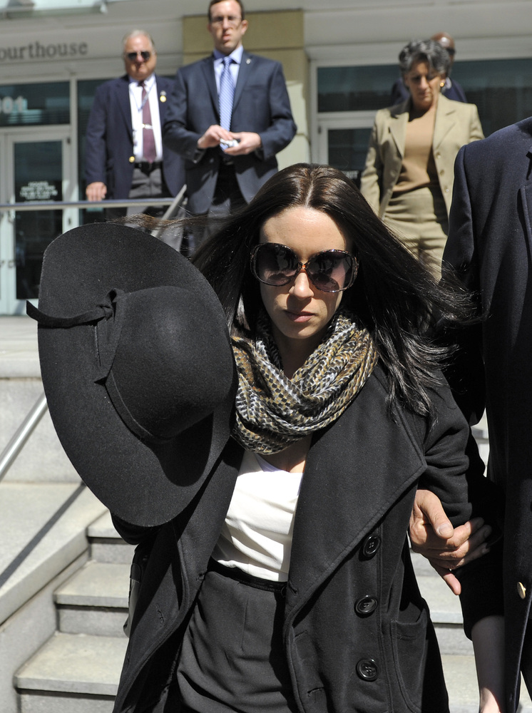 Casey Anthony leaves the federal courthouse in Tampa, after a bankruptcy hearing Monday, March 4, 2013. Anthony, 26, has not