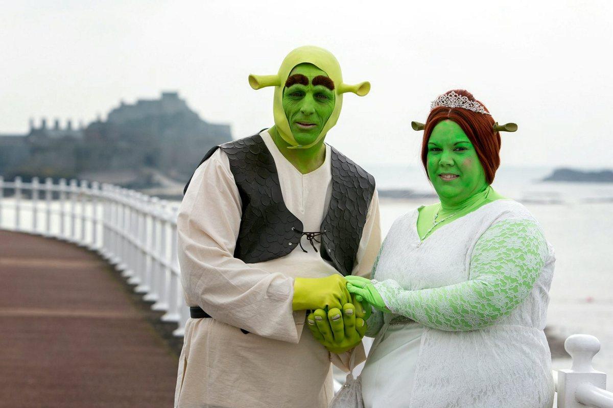 Heidi Coxshall and Paul Bellas dressed as Shrek and Princess Fiona for their wedding.