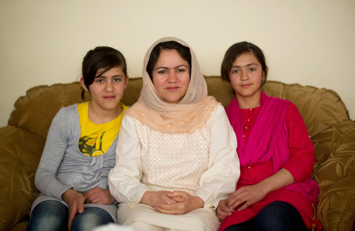 Fawzia Koofi's daughters, shown here, are part of her inspiration to run for president of Afghanistan. She's running on a pla
