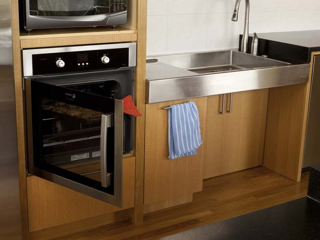 """""""Accessibility principles make kitchens that anyone can enjoy,"""" Pierce told Huff/Post50. """"A side-swing oven door allows the c"""