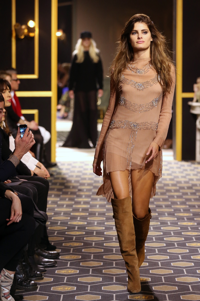 Model Isabeli Fontana presents a creation for H&M during the Fall/Winter 2013-2014 ready-to-wear collection show, on February