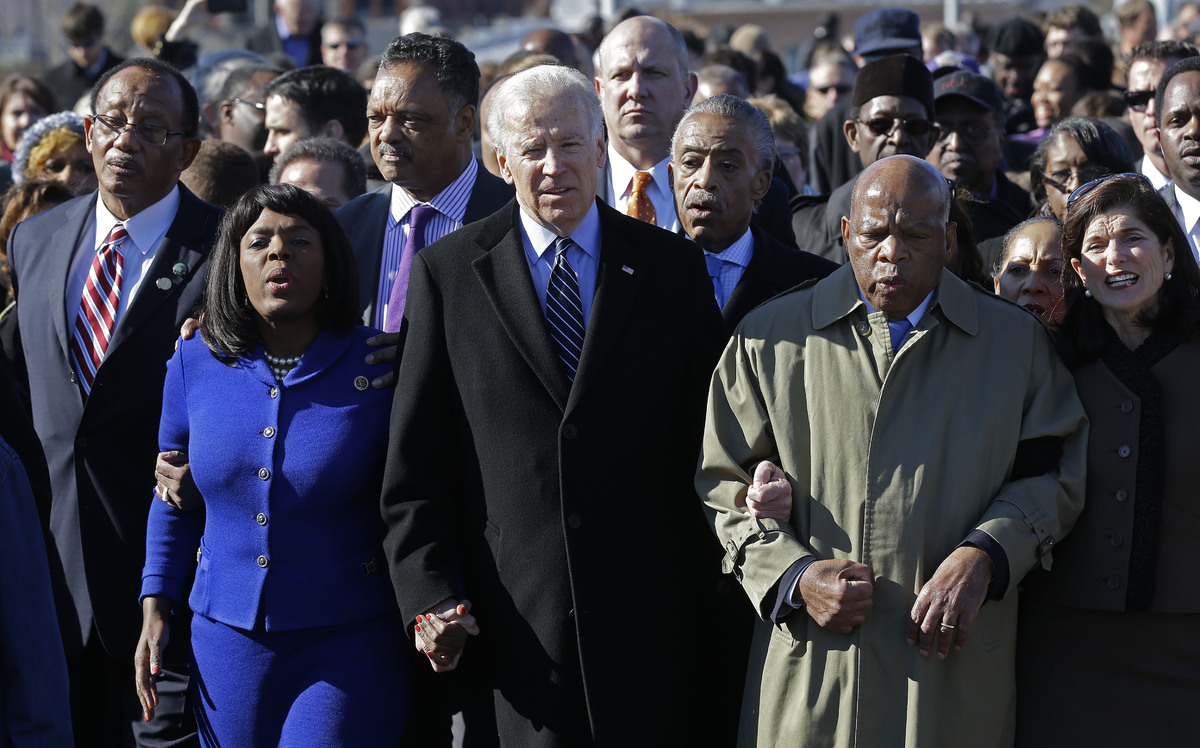 Vice President Joe Biden, center, leads a group across the Edmund Pettus Bridge in Selma, Ala., Sunday, March 3, 2013. They w