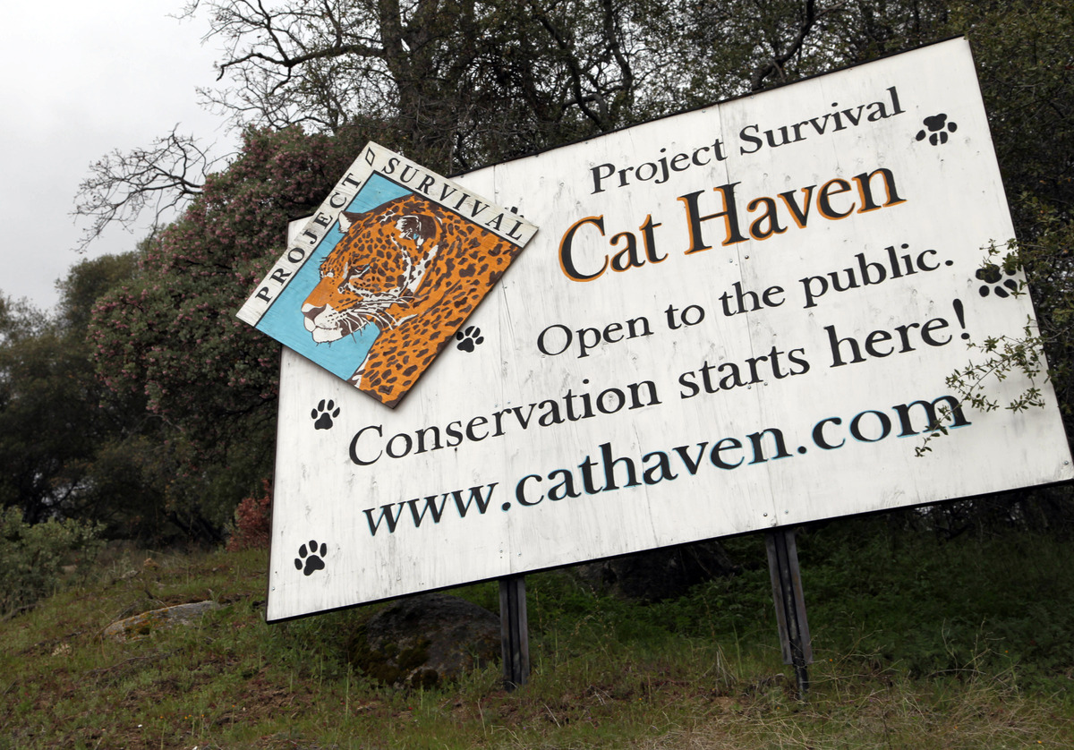 This Wednesday, March 6, 2013 photo shows a sign posted near the gate near at the entrance of Cat Haven, the exotic animal pa