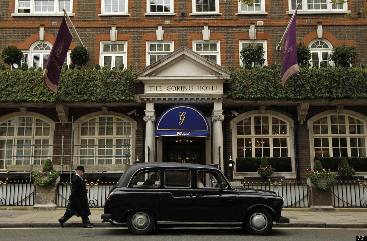 A doorman walks to a black cab outside the Goring Hotel in London, Friday, April 15, 2011.  It was announced Friday that Kate