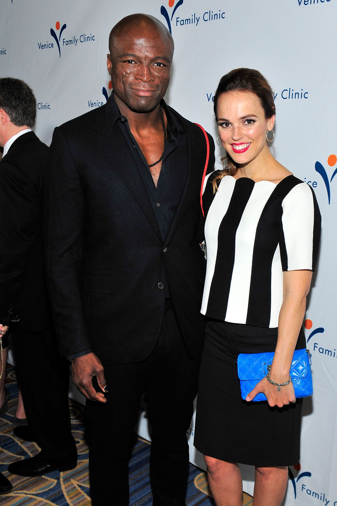 "Rumors that musician Seal, 50, and actress Erin Cahill, 33, are dating, started swirling after the <a href=""http://www.usmaga"