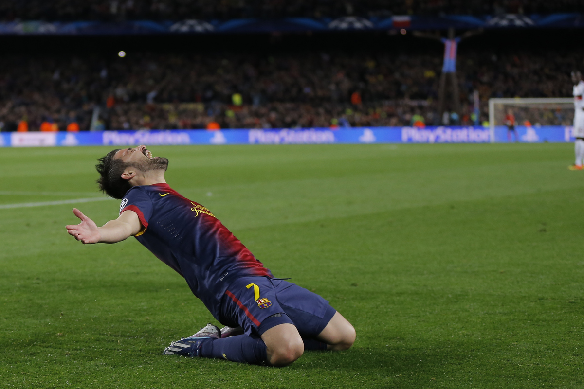Barcelona's forward David Villa reacts after scoring his side's third goal during the Champions League round of 16 second leg