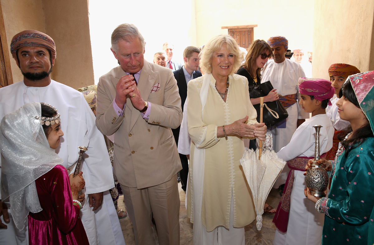 NIZWA, OMAN - MARCH 18:  Prince Charles, Prince of Wales and Camilla, Duchess of Cornwall wash their hands as they visit Nizw