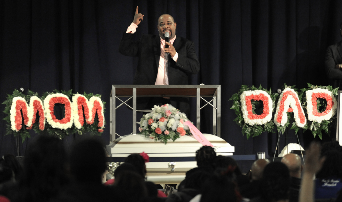 Rev. Corey Brooks speaks during the funeral for 6-month old Jonylah Watkins' at New Beginnings Church in Chicago, Tuesday, Ma