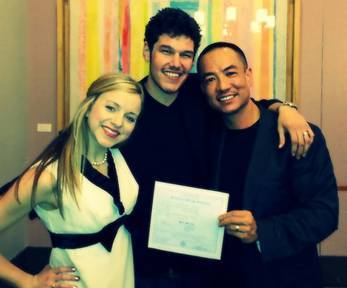 In-flight crewmember Virginia (left), with the happy couple showing off their marriage certificate