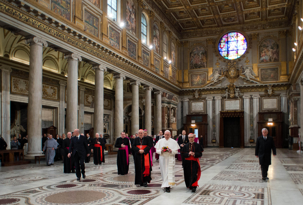 In this photo provided by the Vatican newspaper L'Osservatore Romano, Pope Francis,center, flanked at left by Cardinal Agosti