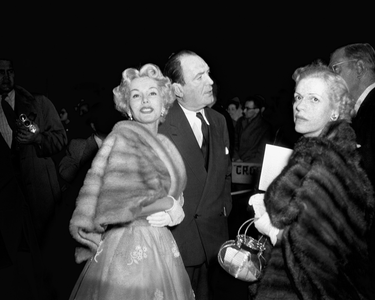Actress Zsa Zsa Gabor and husband/actor George Sanders arrive at the 25th annual Academy Awards' New York ceremony held at th