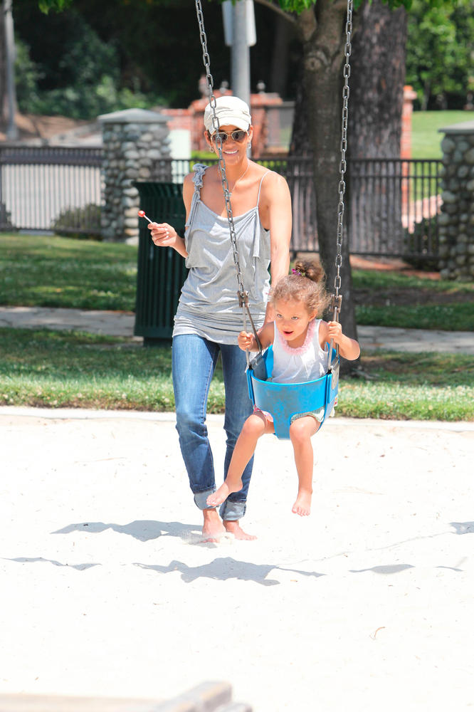 Halle Berry and daughter Nahla Aubrey play on the slide, swings and sand at a Beverly Hills park in May 2011.