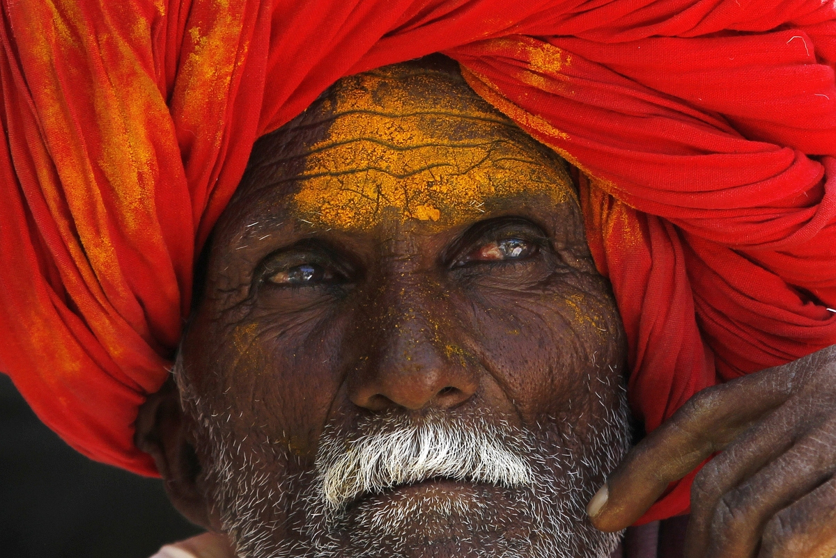 In this Monday, March 11, 2013 photo, a devotee waits for a procession at the temple of the shepherd god Khandoba on 'Somavat