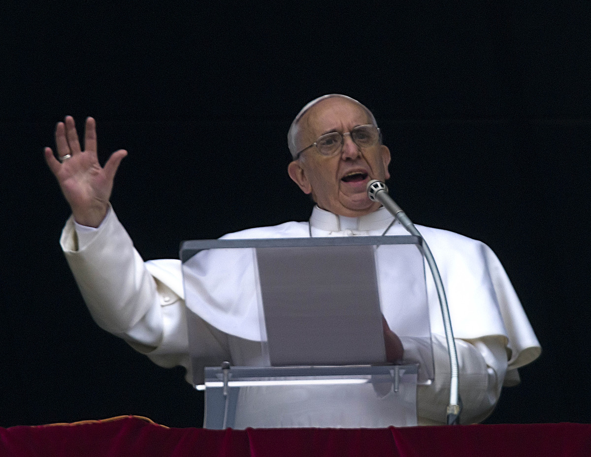 Pope Francis gestures as he delivers his Angelus prayer from the window of his studio overlooking St. Peter's Square, at the