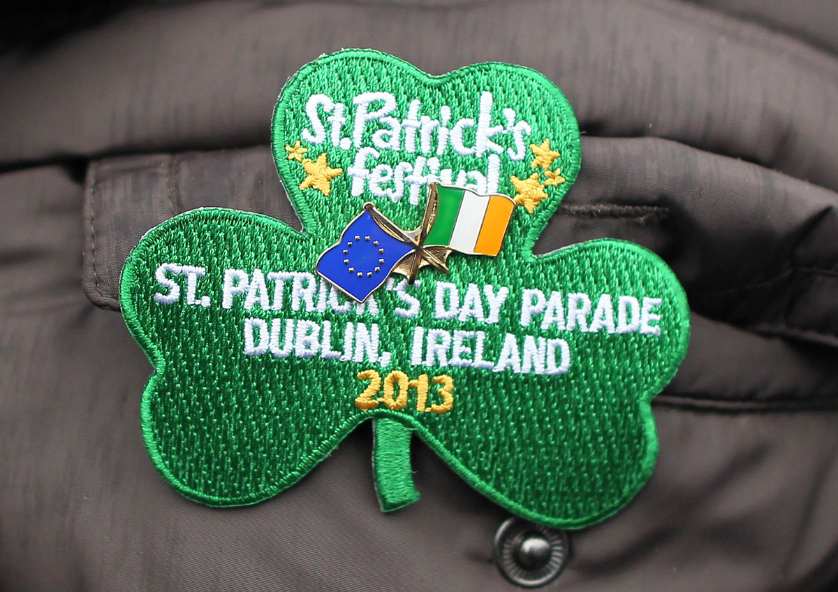 A parade goer wears a shamrock patch on their jacket during St Patrick's Day festivities in Dublin on March 17, 2013. More th