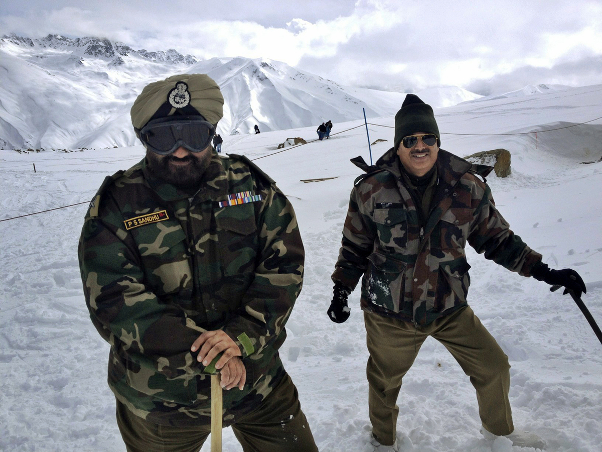 Indian Army soldiers stand on the top of Mount Affarwat at Gulmarg, Kashmir. Gulmarg, a ski resort nestled in the Himalayan m