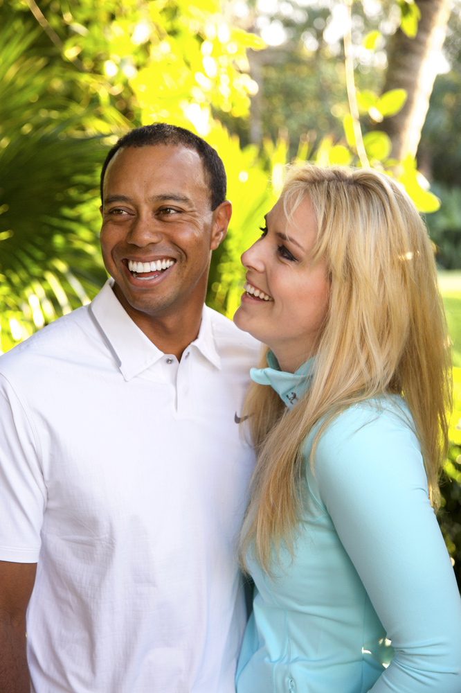 In this 2013 photo provided by Tiger Woods and Lindsey Vonn, golfer Tiger Woods and skier Lindsey Vonn pose for a portrait. T