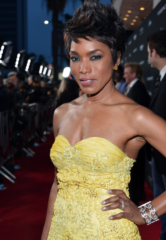 HOLLYWOOD, CA - MARCH 18:  Actress Angela Bassett arrives at the premiere of FilmDistrict's 'Olympus Has Fallen' at ArcLight