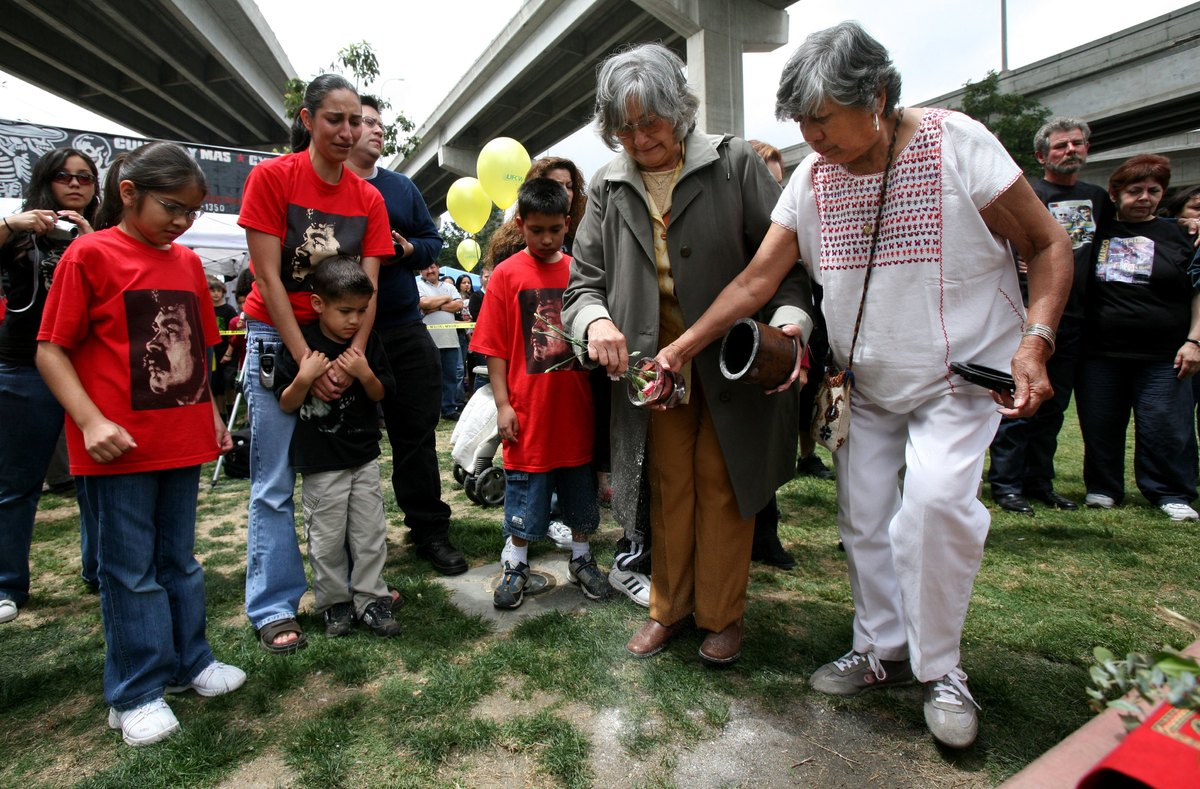 SAN DIEGO - APRIL 22:  Geraldine Gonzales (C-R), wife of popular Chicano leader Corky Gonzalez, spreads his ashes with help f