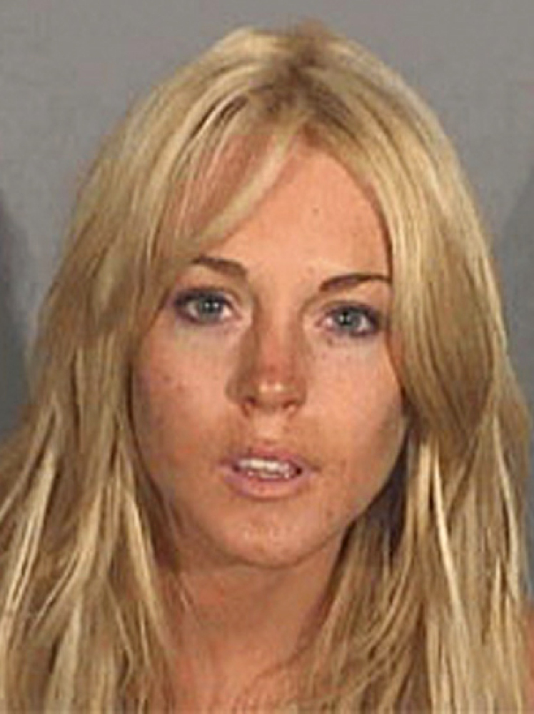 In this July 24, 2007 file photo, Lindsay Lohan, is shown in a booking mug released by the Santa Monica Police Department, in
