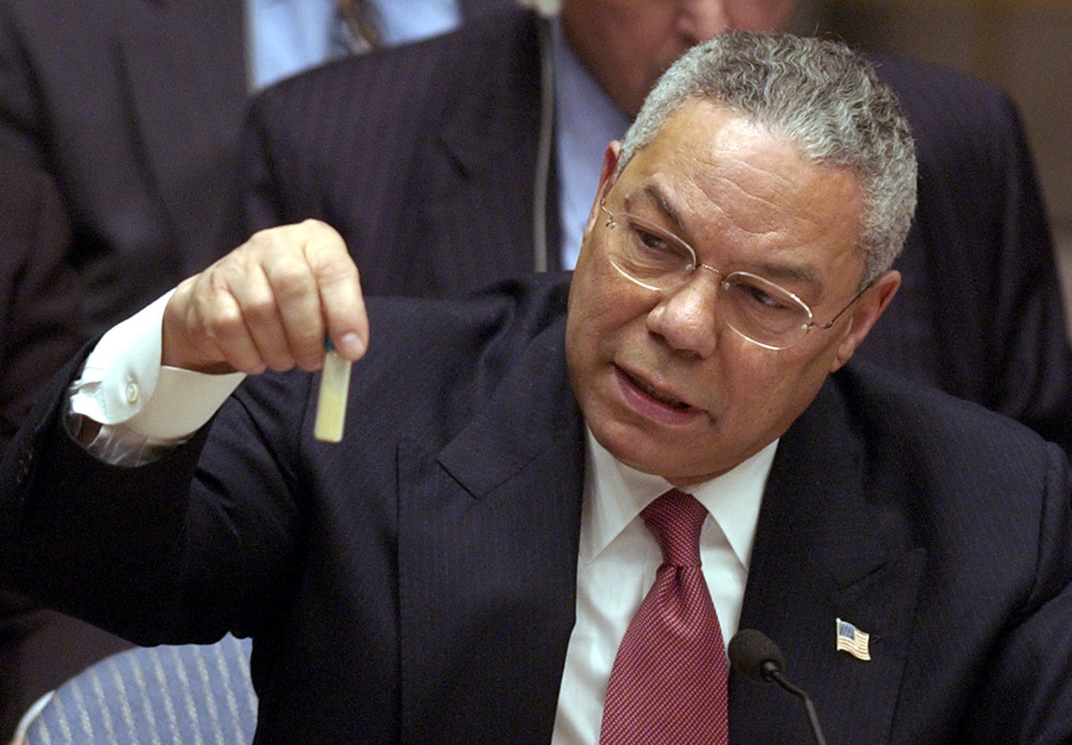 U.S. Secertary of State Colin Powel holds up a vial that he said could contain anthrax during a meeting of the United Nations