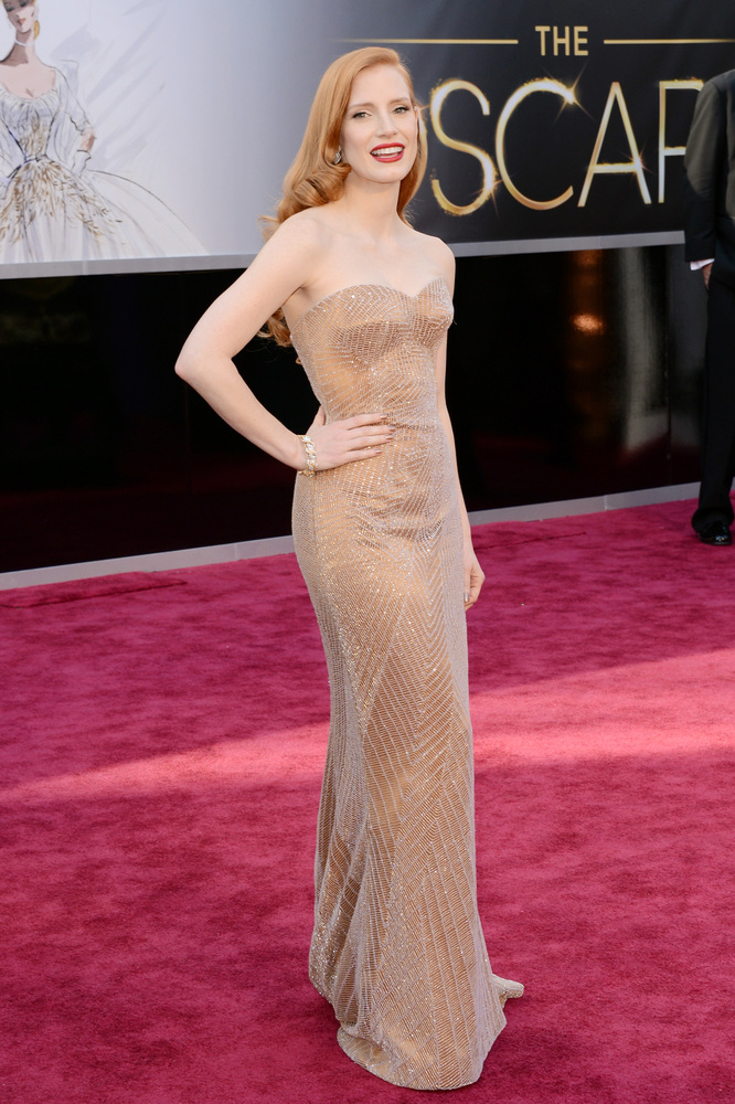 in an Armani Privé dress, Christian Louboutin shoes and Harry Winston jewelry.