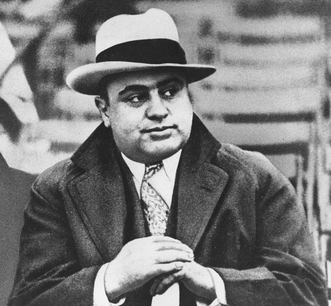 In this Jan. 19, 1931 file photo, Chicago mobster Al Capone attends a football game in Chicago. Even today, the city has some