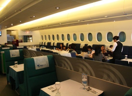 This Taipei spot replicates the in-flight experience with an interior designed to look like an airplane cabin with servers dr