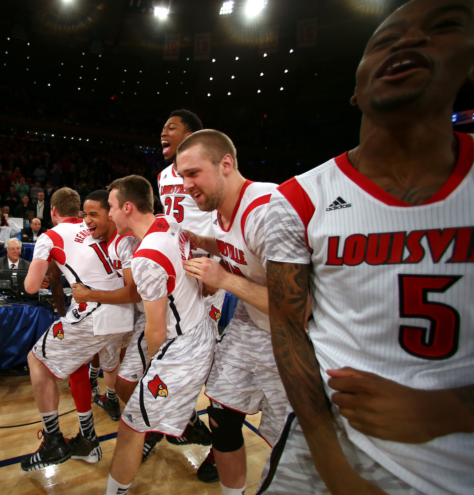 NEW YORK, NY - MARCH 16:  The Louisville Cardinals celebrate after they won 78-61 against the Syracuse Orange during the fina