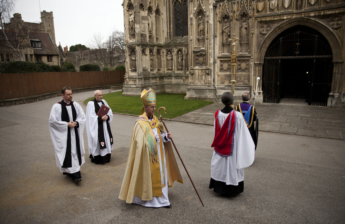 Britain's new Archbishop of Canterbury Justin Welby, centre, arrives for his enthronement ceremony at Canterbury Cathedral in